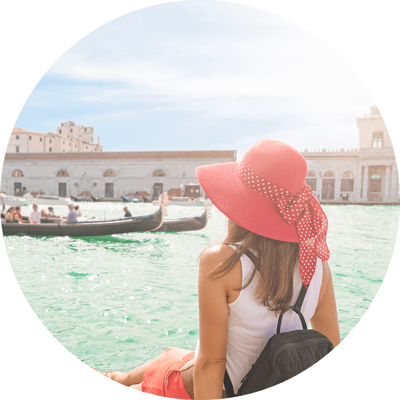 Woman watching gondola in Venice