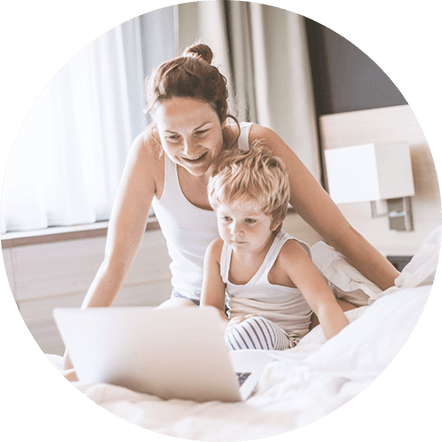 Woman and child looking at laptop in hotel room