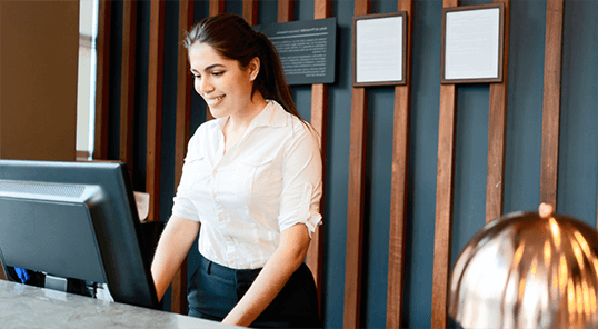 Woman working at hotel check-in desk